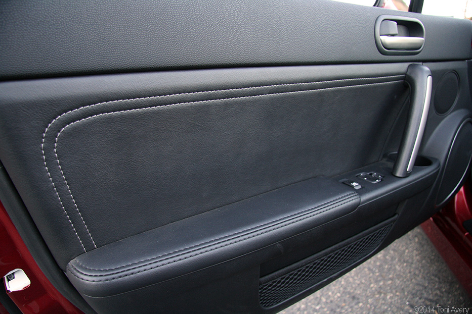 Here is a picture of the door panel I need & black w/ white stitching door panel part # - MX-5 Miata Forum
